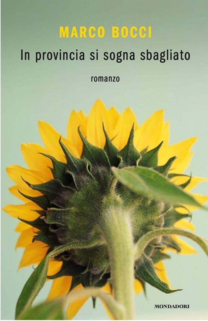Marco Bocci: In provincia si sogna sbagliato. Copertina del libro con girasole