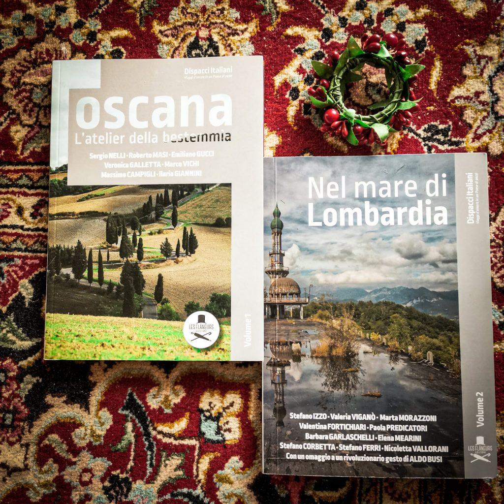 Dispacci italiani: i primi due libri della collana adagiati su un tappeto rosso